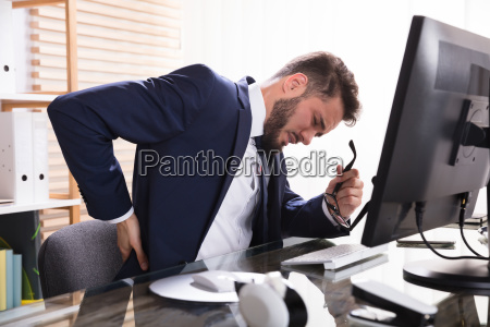 businessman, suffering, from, backache - 23610406
