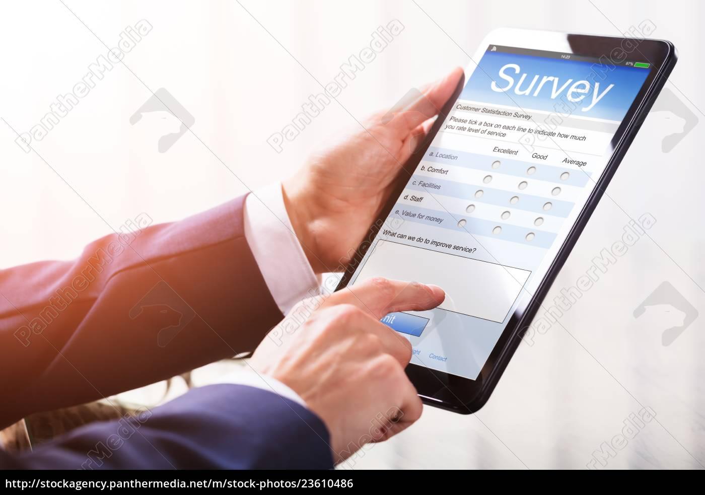 businessperson, filling, online, survey, form, on - 23610486