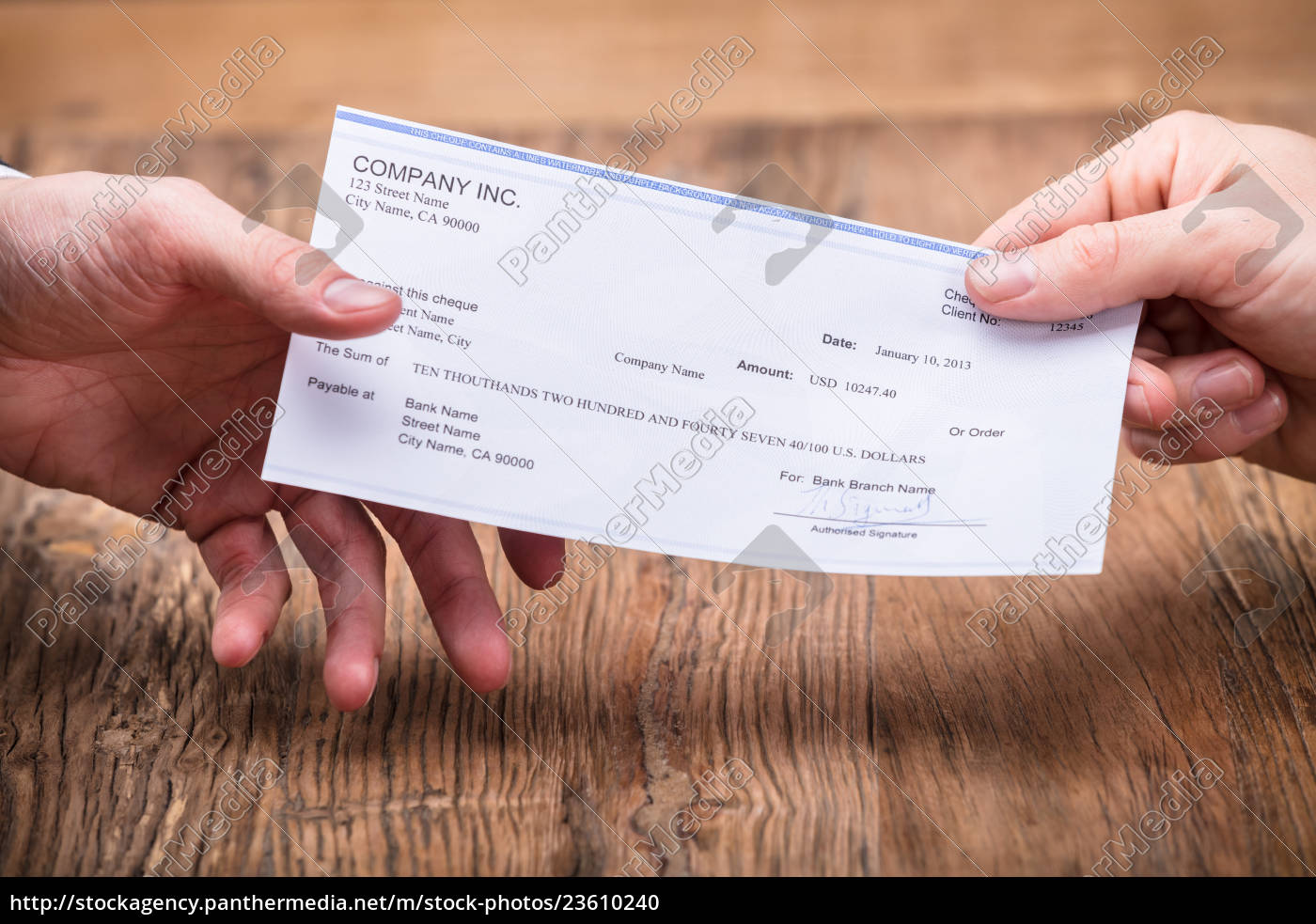 businessperson's, hand, giving, cheque, to, partner - 23610240