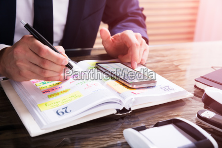businessperson, using, mobile, phone - 23610430