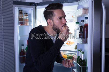 close-up, of, a, man, eating, cookie - 23610300
