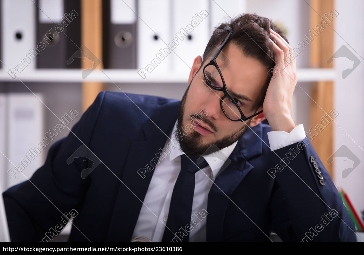 close-up, of, a, sad, businessman - 23610386