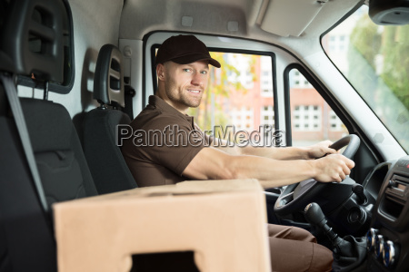 delivery, man, sitting, inside, van, with - 23610684