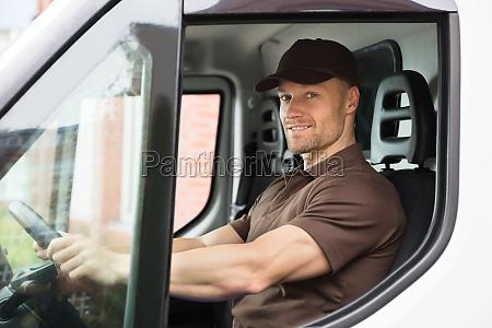 happy, delivery, man, sitting, inside, van - 23610682