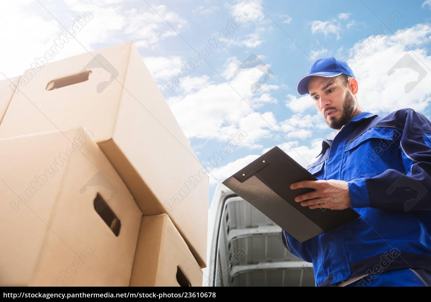 male, worker, standing, near, cardboard, box - 23610678