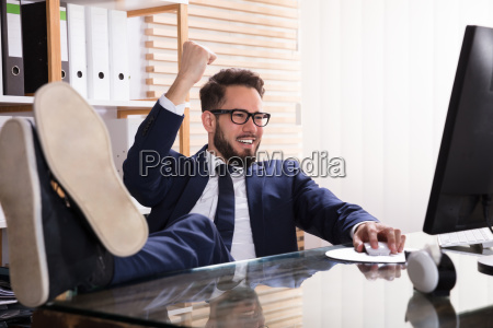 relaxed, businessman, working, on, computer - 23610412