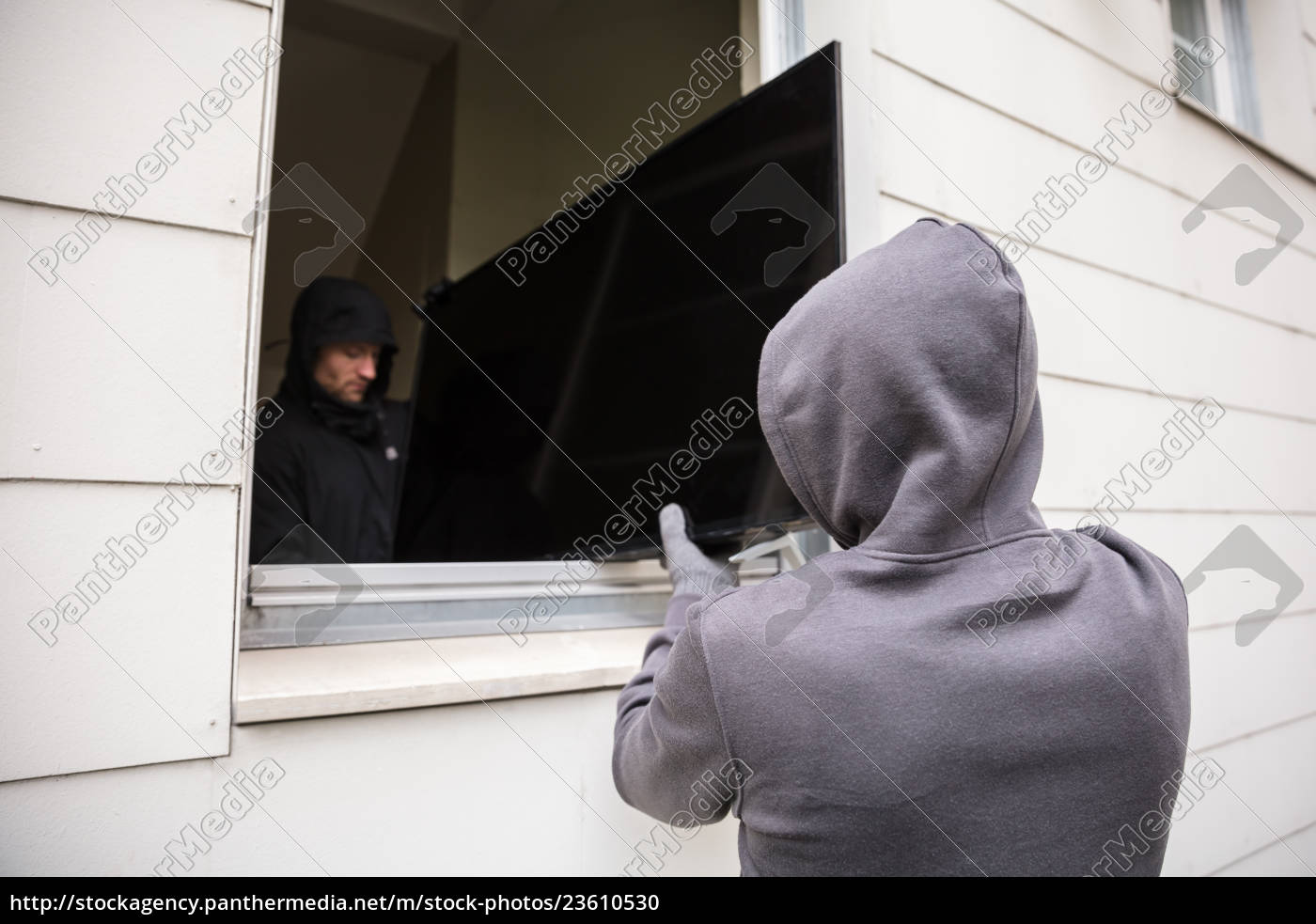 robbers, stealing, television, through, house, window - 23610530
