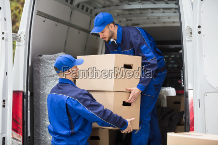 two, movers, carrying, cardboard, box - 23610668