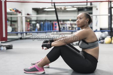 black woman sitting on floor in