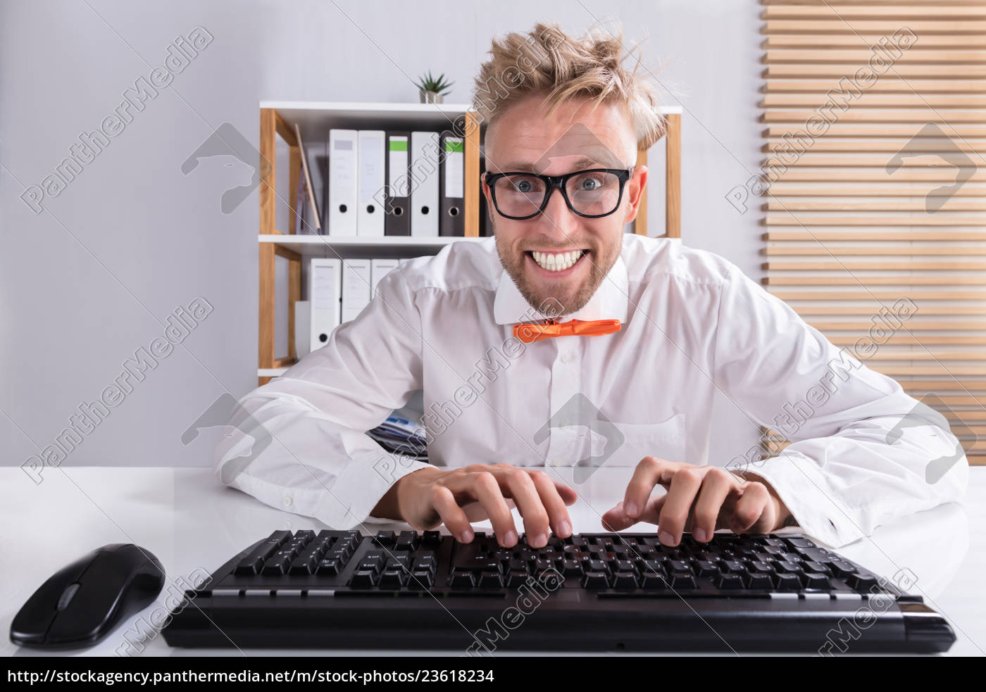 businessman, in, orange, bow, typing, on - 23618234