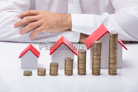 businessman, with, different, size, houses, and - 23618138