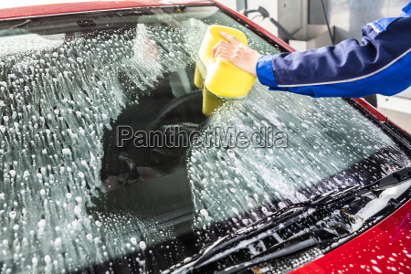 hand, cleaning, car, windshield, with, sponge - 23618306