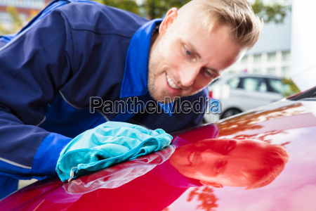 happy, male, worker, cleaning, red, car - 23618280