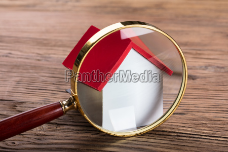 magnifying, glass, and, green, paper, house - 23618216