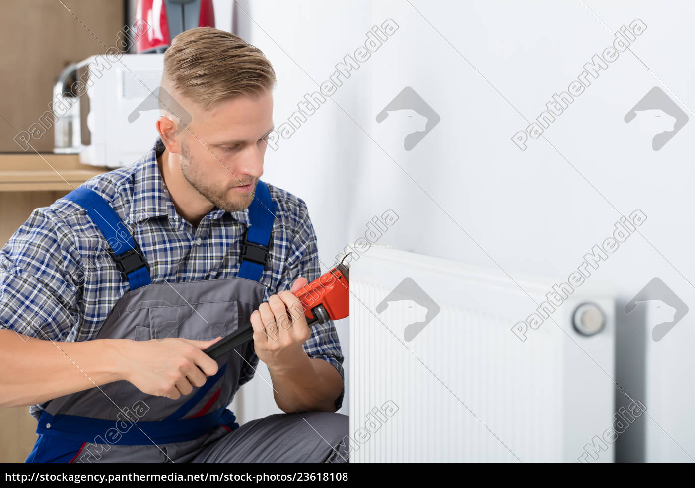male, plumber, fixing, thermostat, using, wrench - 23618108