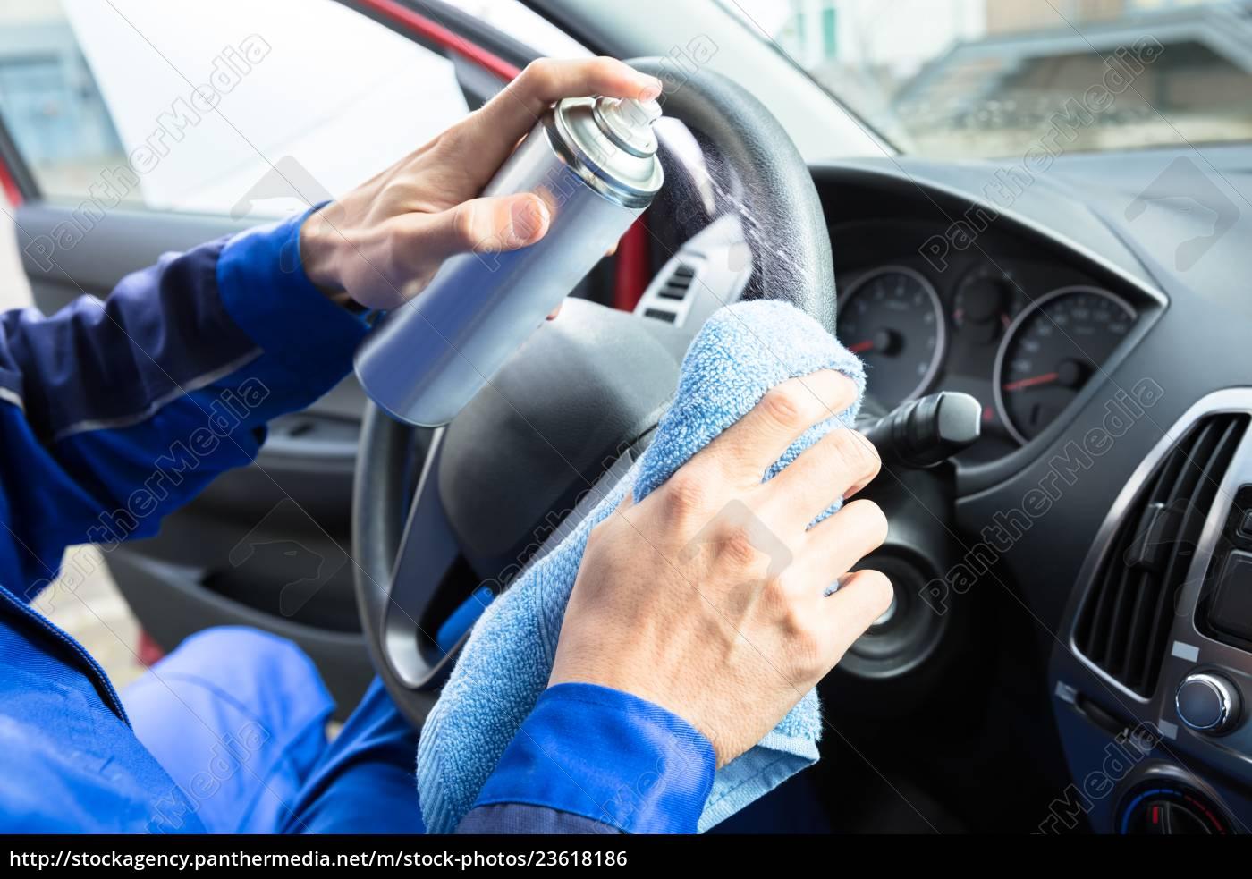 man, cleaning, car, steering, wheel - 23618186