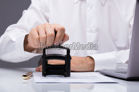 person's, hand, stamping, with, approved, stamp - 23618134