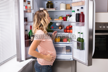 pregnant woman looking for food