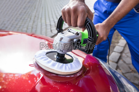 hands, polishing, car, with, orbital, polisher - 23620314