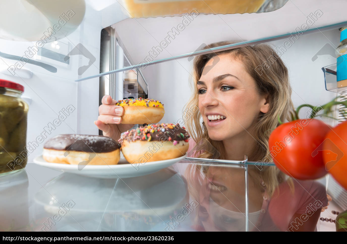happy, woman, taking, donut, from, plate - 23620236