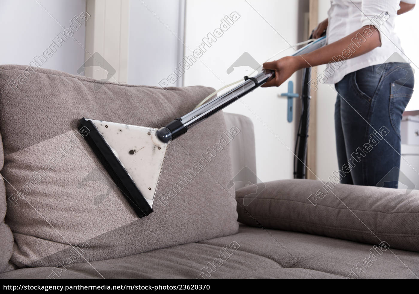 housewife, cleaning, sofa, with, vacuum, cleaner - 23620370
