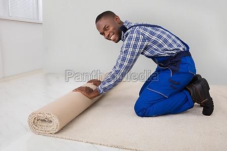male, handyman, rolling, carpet - 23620286