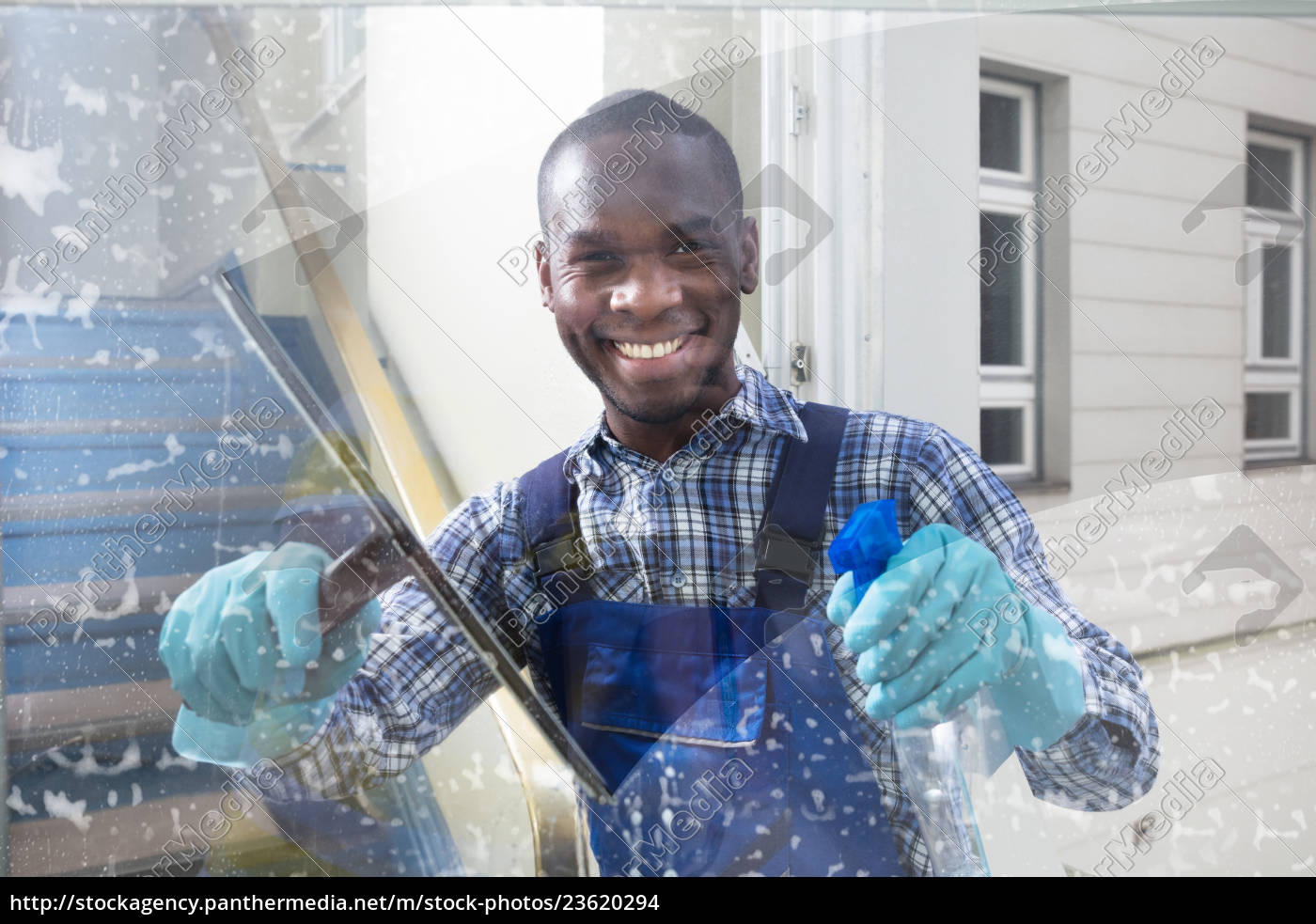 male, worker, cleaning, glass, with, squeegee - 23620294