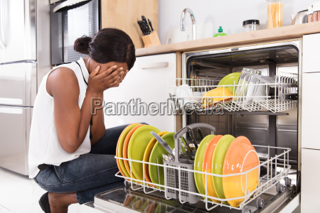 sad, woman, crouching, near, dishwasher - 23620448