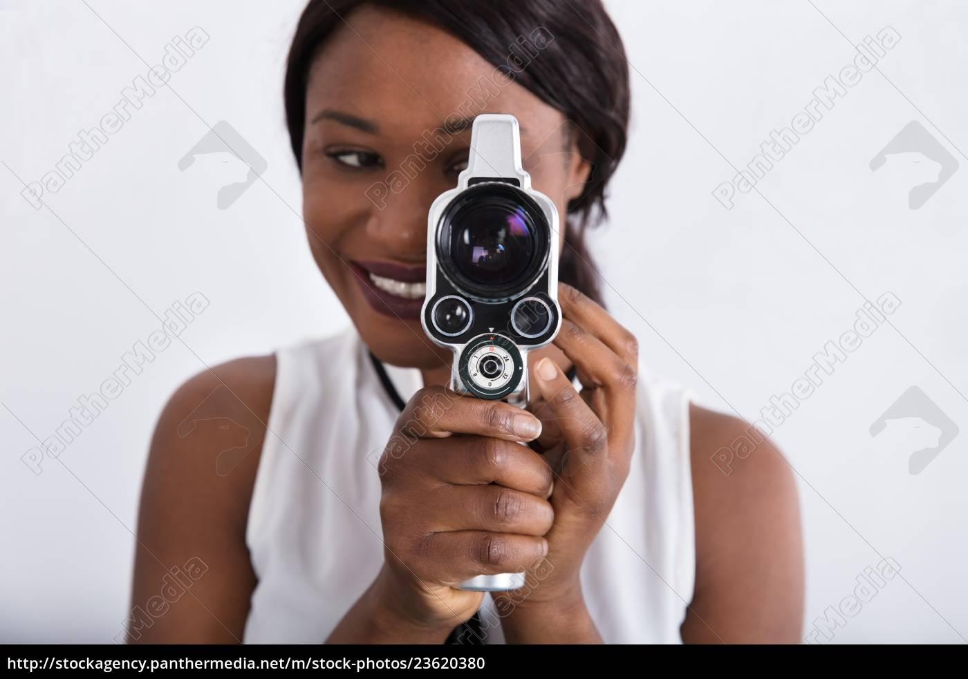 woman, looking, through, lens, of, retro - 23620380