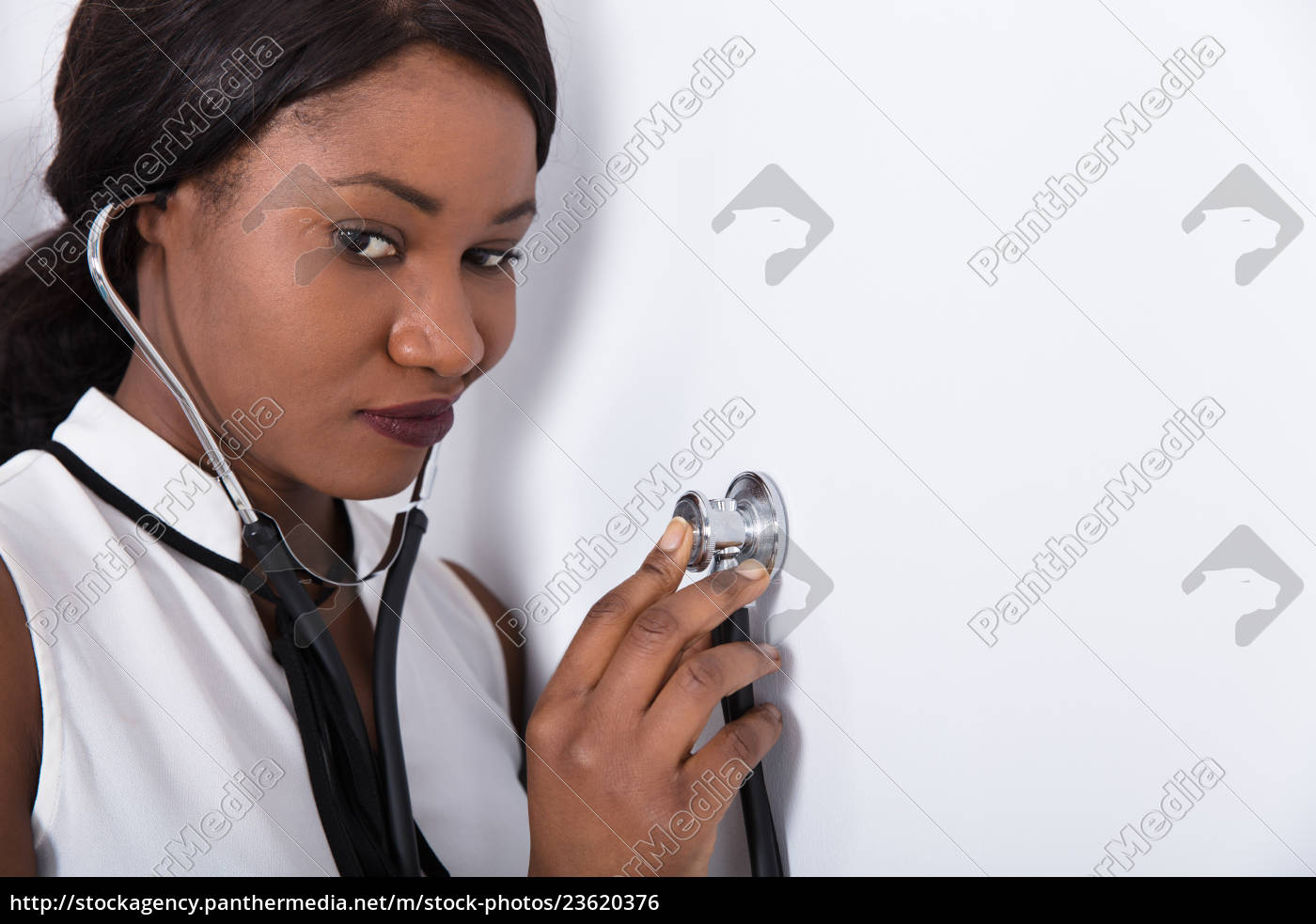 woman, placing, stethoscope, on, wall - 23620376