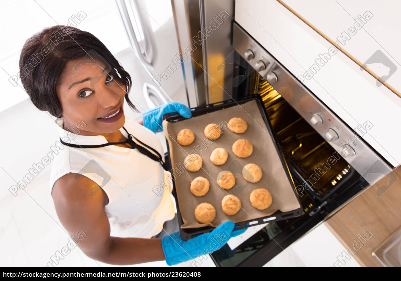 woman, taking, out, tray, of, baked - 23620408