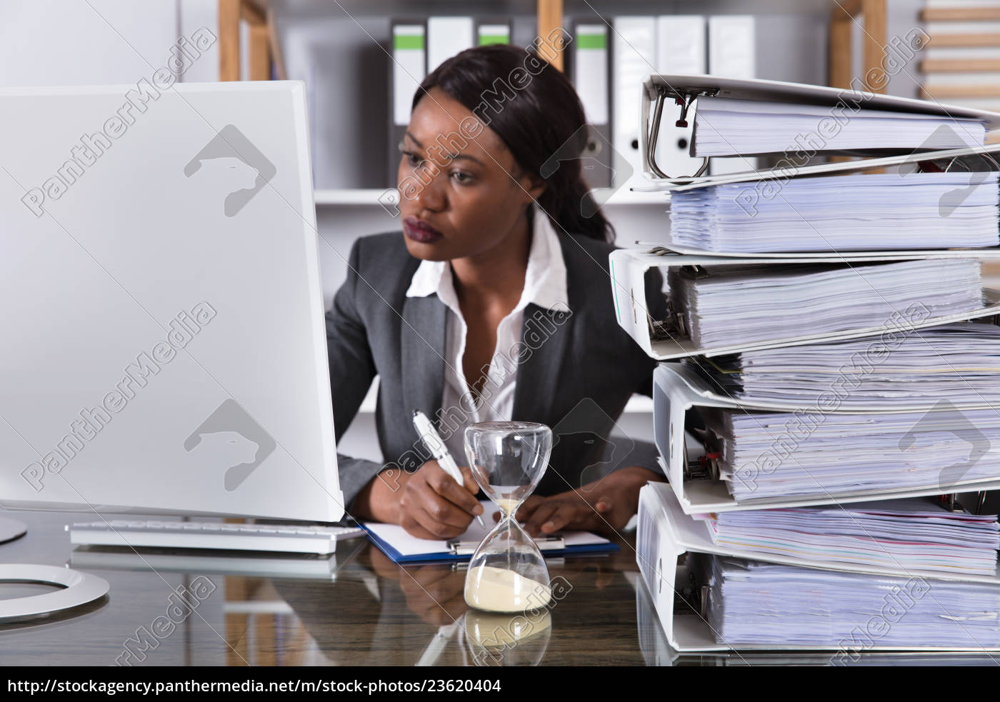 young, african, woman, working, on, computer - 23620404