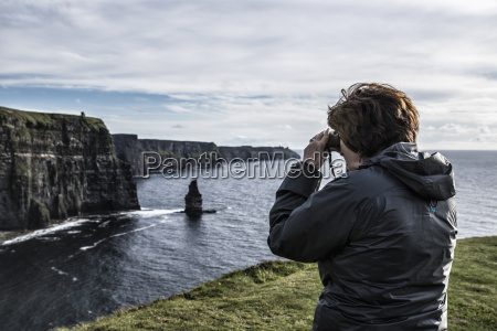 ireland clare county woman looking through