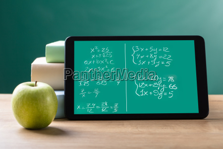 digital tablet with mathematical equations on