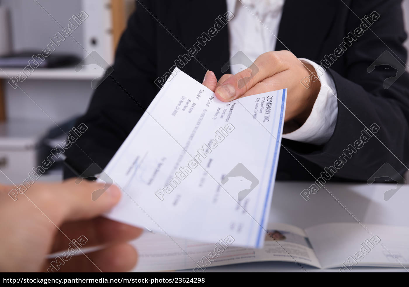 business, woman, handing, over, cheque, to - 23624298