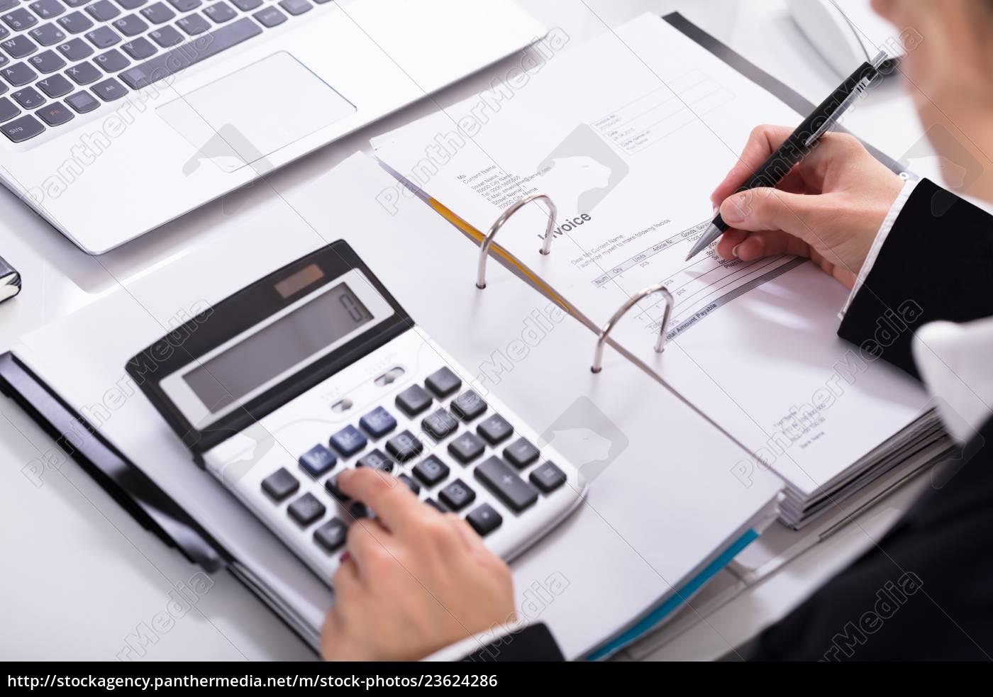 businesswoman, hand, calculating, invoice, using, calculator - 23624286