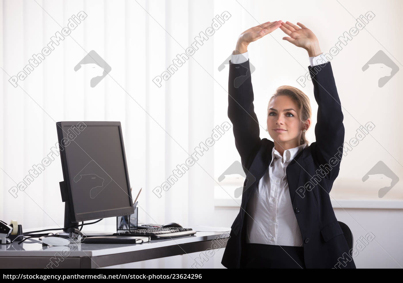 businesswoman, sitting, on, chair, stretching, her - 23624296