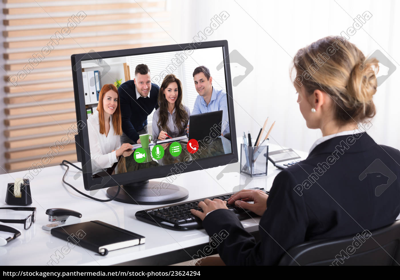 businesswoman, video, conference, with, her, colleagues - 23624294