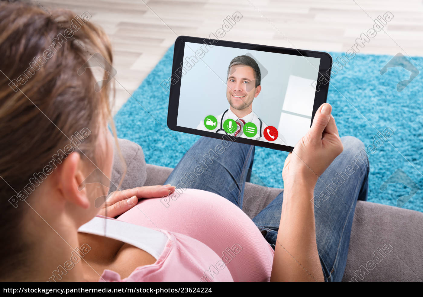 pregnant, woman, video, conferencing, with, male - 23624224