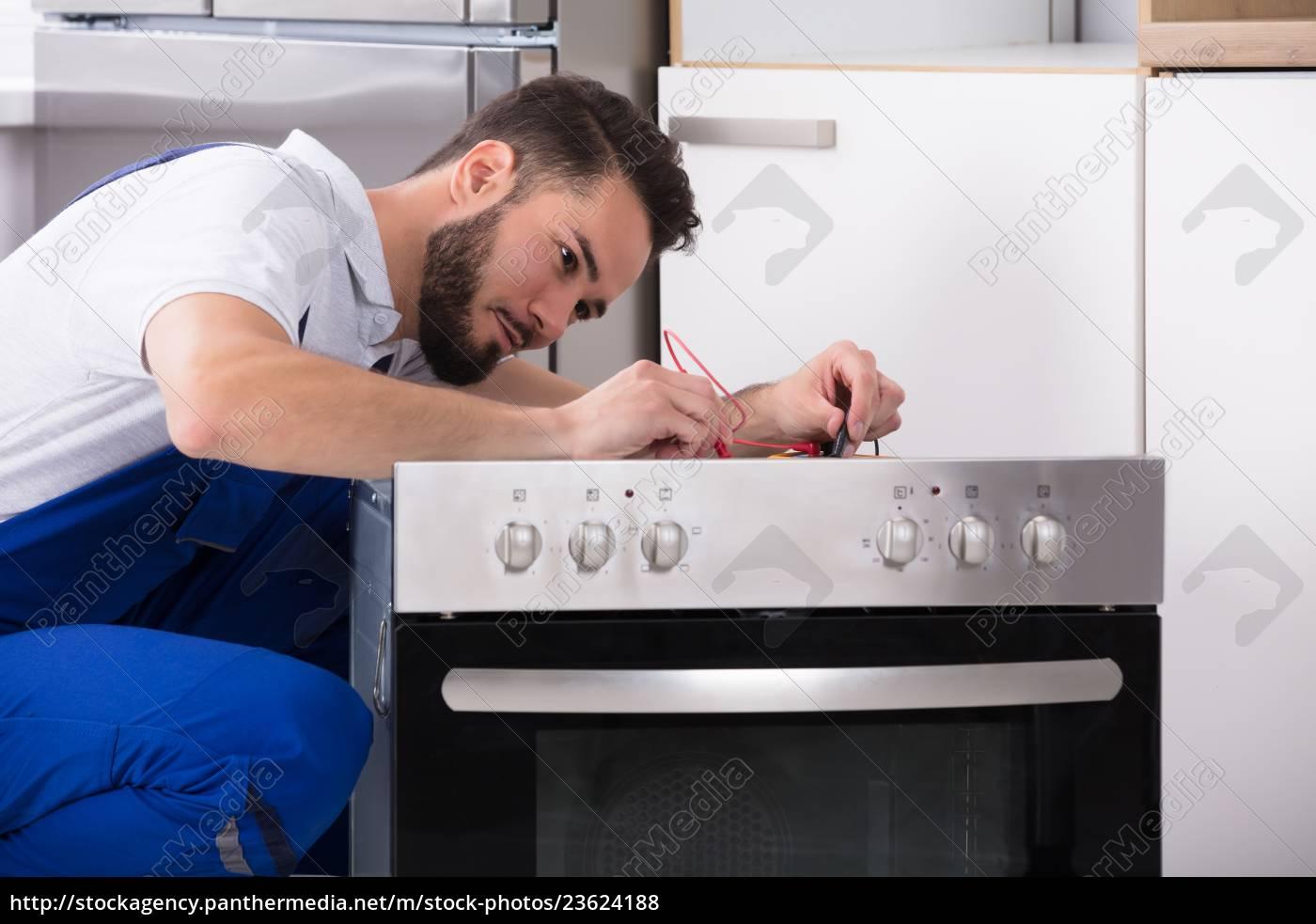 repairman, repairing, oven - 23624188