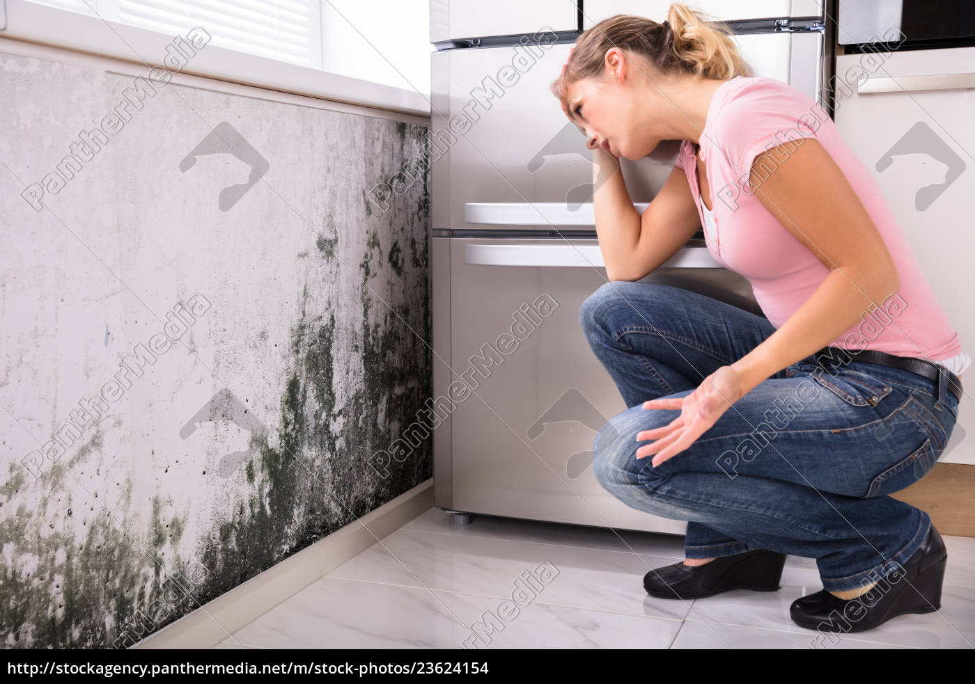 shocked, woman, looking, at, mold, on - 23624154