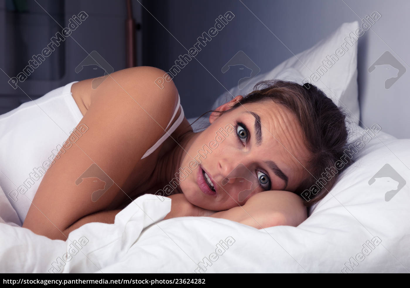 woman, pulling, bed, sheet, over, self - 23624282