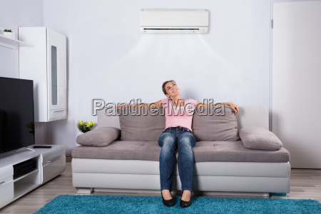 woman, relaxing, under, the, air, conditioner - 23624222