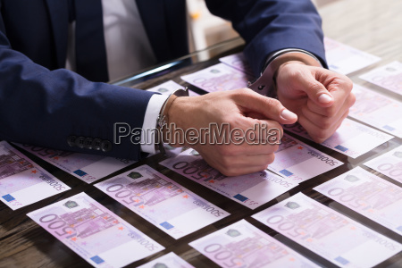 businessperson in handcuffs arrested for bribe