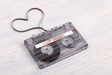 audio cassette tape on wooden background