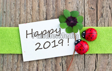 new year card with leafed clover