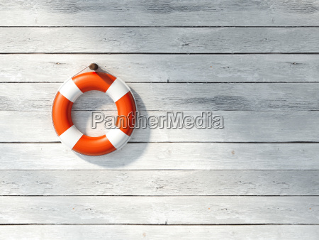 red lifebuoy on a white wall