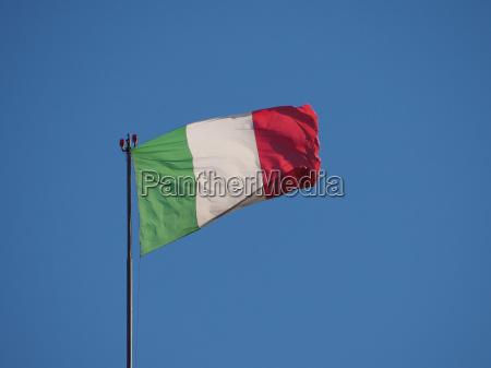 italian flag of italy over blue