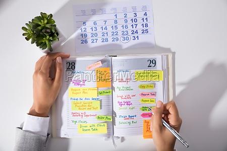 businesswoman hands with calendar writing schedule