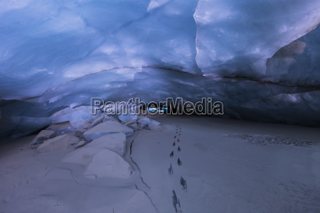 footsteps reveal solid ice beneath a